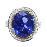 Solitaire Blue Sapphire Set in Gold With Platinum Oval Band