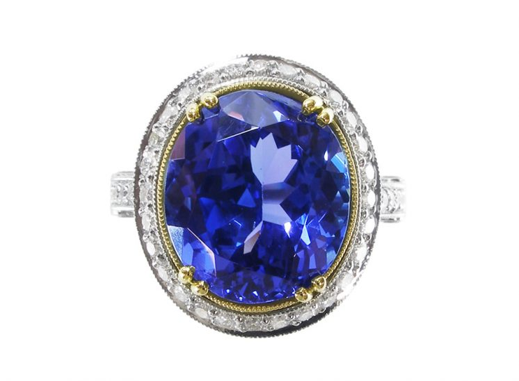 Custom Solitaire Blue Sapphire Set in Gold With Platinum Oval Band