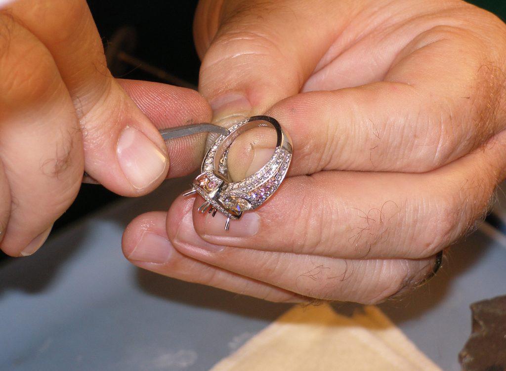 Working on Custom Diamond & Platinum Three Stone Ring With Pink Diamonds Set in Rose Gold